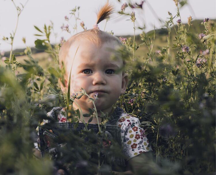 Baby Girl in Flowers