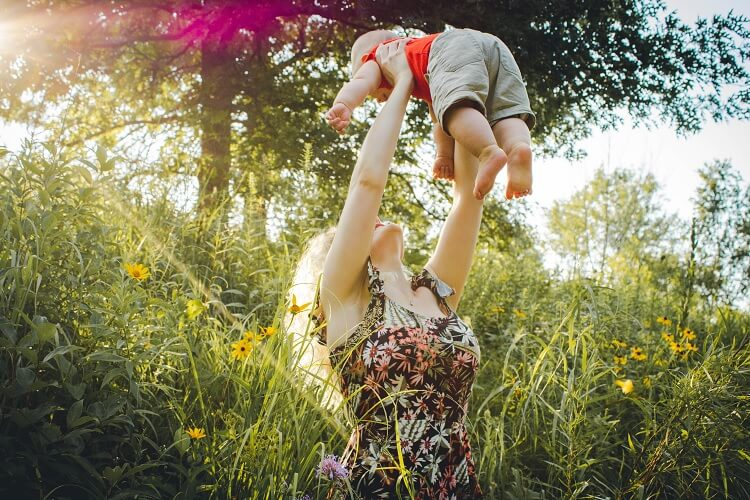 Hippie Mother and Child in Meadow