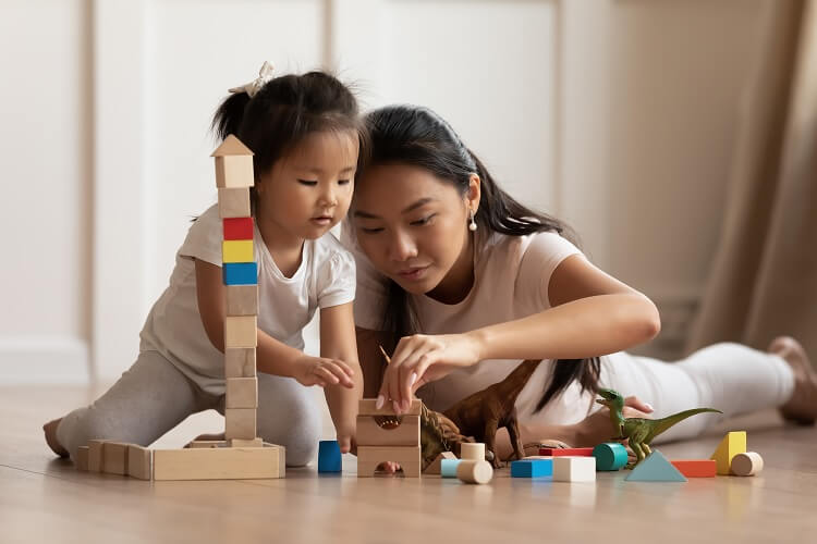 Japanese Girl Playing With Mother